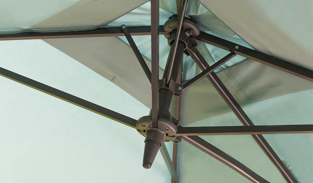 Detail of the 2.5m Free Arm Parasol in aqua.