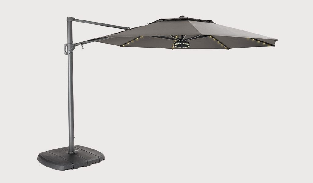 3.3m Free Arm Parasol with Taupe fabric on a grey background.