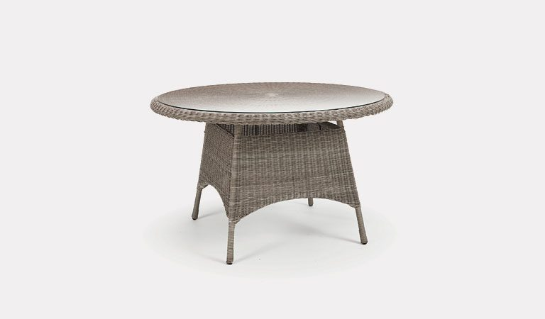 Banaba 125cm Round table from KETTLER's Classic Garden furniture range on a grey background.