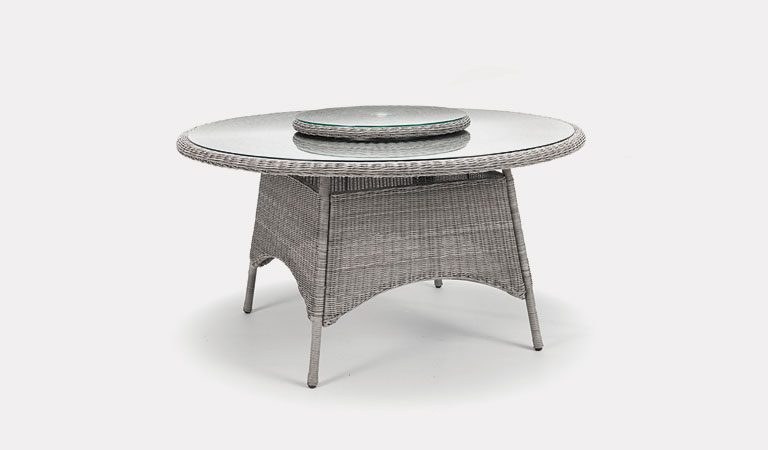 Banaba 144cm Round table from KETTLER's Classic Garden furniture range on a grey background.