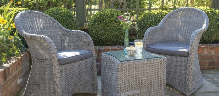 Banaba Chairs and 45x45cm Table in White Wash from KETTLER's Classic Garden Furniture range on a patio.