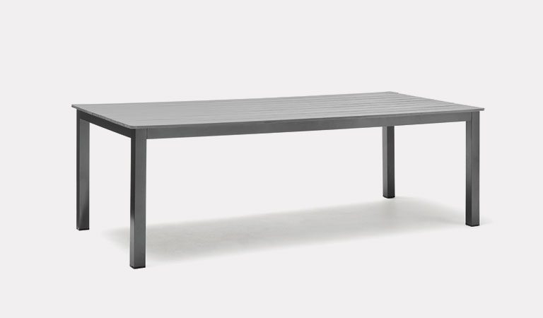 Bretagne 220x100cm Table in Grey from KETTLER's Classic garden furniture range on a grey background.