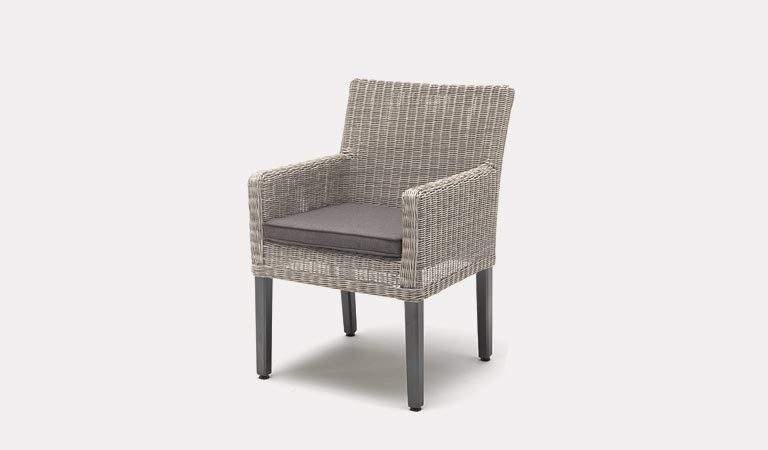 The Bretagne Dining Chair in White Wash from KETTLER's Classic Garden furniture range on a grey background.