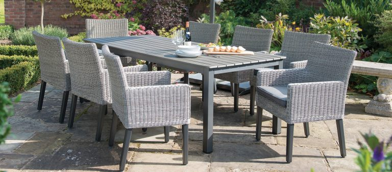 Bretagne 8 Seater Dining Set in white wash from KETTLER's Classic Garden Furniture range on a patio.