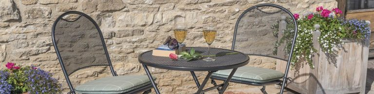 Caffe Roma Bistro Set with Sage Check cushions on a patio