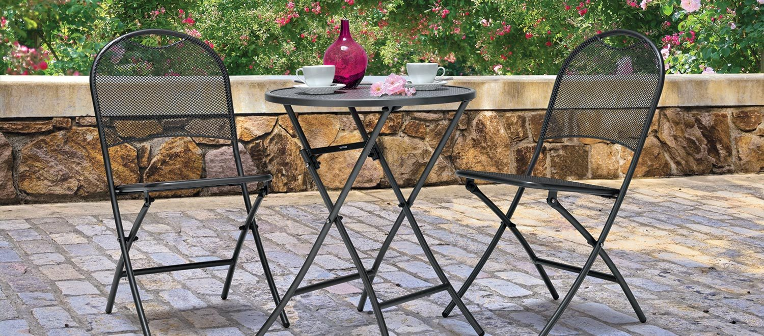 Caffe Roma Bistro Set from KETTLER's Classic range in a garden.