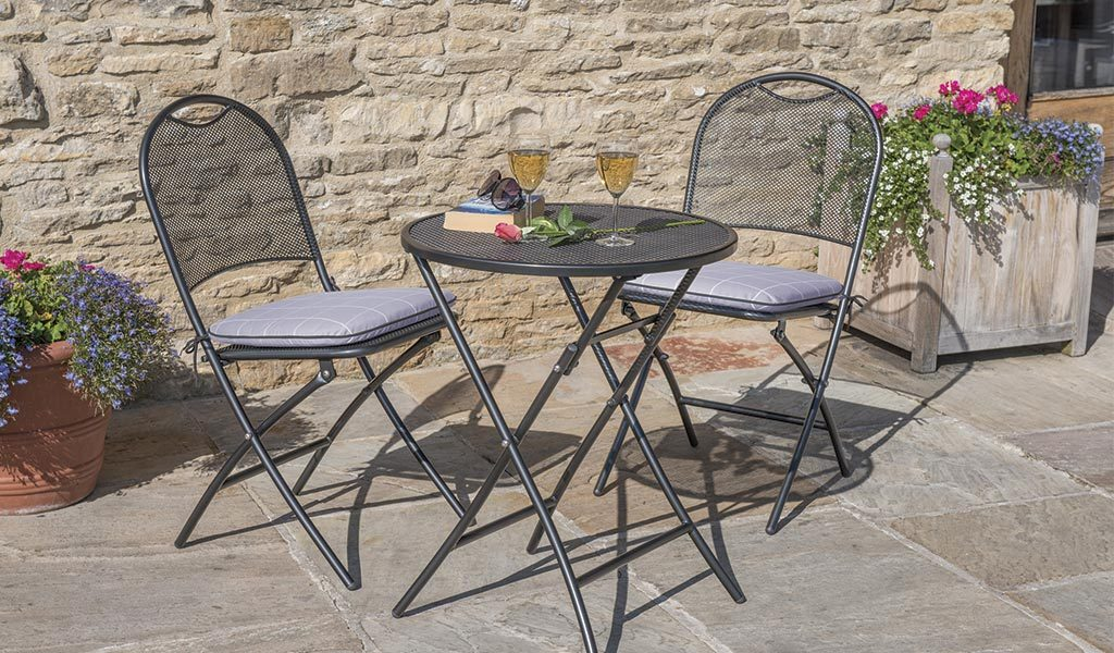 Caffe Roma Bistro Set with Wisteria Check cushions on a patio