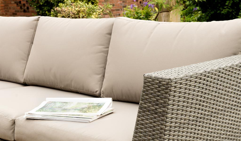 Detail of the Caleta Sofa in a garden