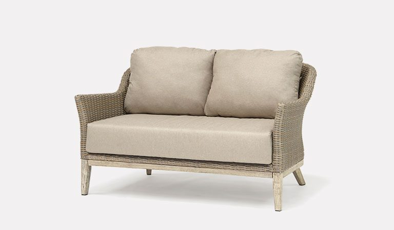 The Cora 2 Seater Sofa from KETTLER's garden furniture range on a grey background.