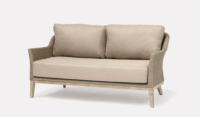 The Cora 3 Seater Sofa from KETTLER's garden furniture range on a grey background.