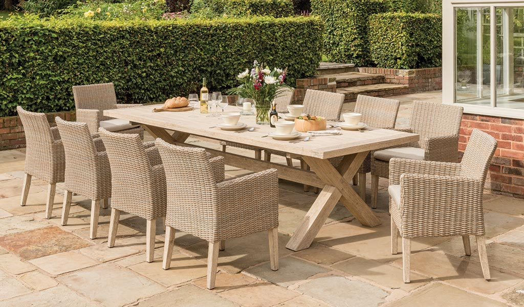 Cora Armchair Dining Set from KETTLER's Elegance range in a garden