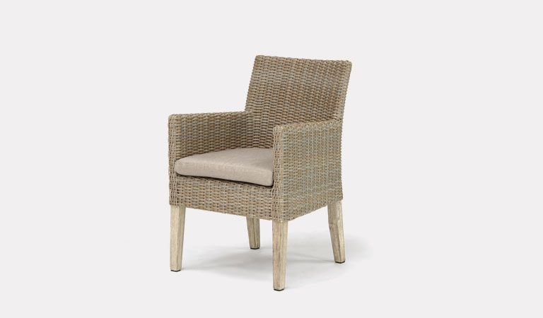 The Cora Dining Armchair from KETTLER's Elegance Garden furniture range on a grey background.