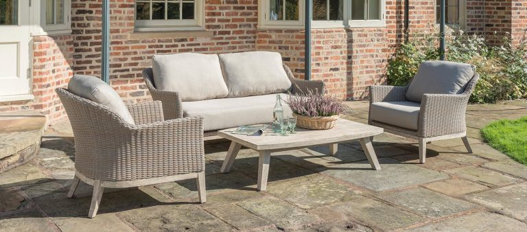 The Cora 2 Seater Sofa, Cora Lounge Armchair and Cora Coffee Table on a patio.