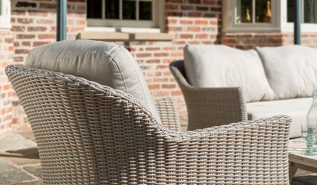 Detail of the Cora Lounge Armchair from KETTLER's Elegance range on a patio