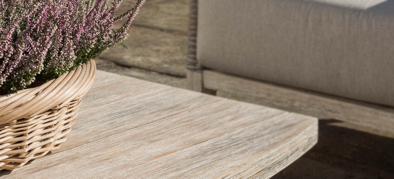 Close up image of the Cora Coffee Table from KETTLER's wood garden furniture range.