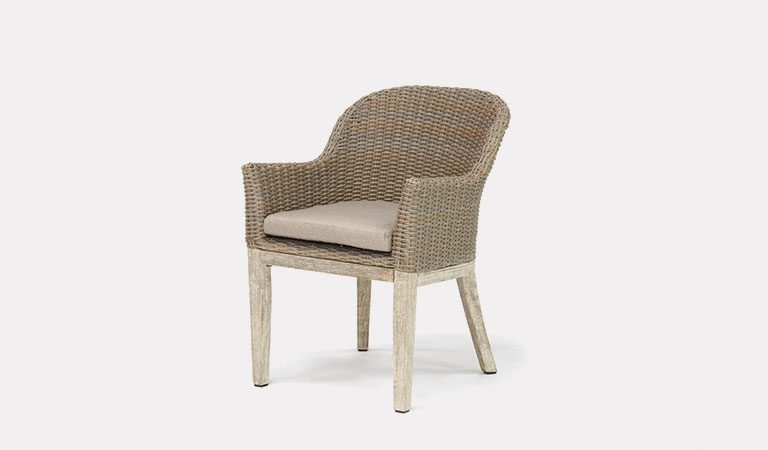 The Cora Round Back Dining Chair from KETTLER's Elegance Garden furniture range on a grey background.