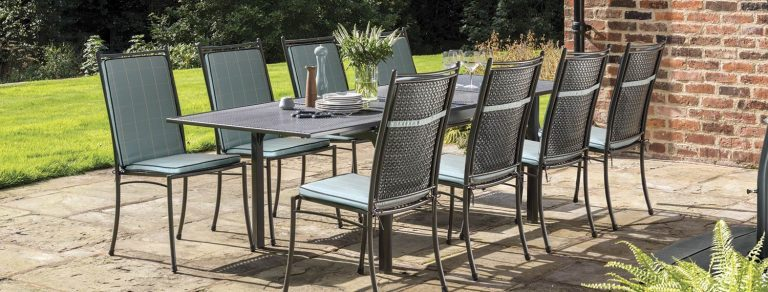 The Cortona 8 Seater Side Chair Dining Set with Aqua Check cushions on a patio.