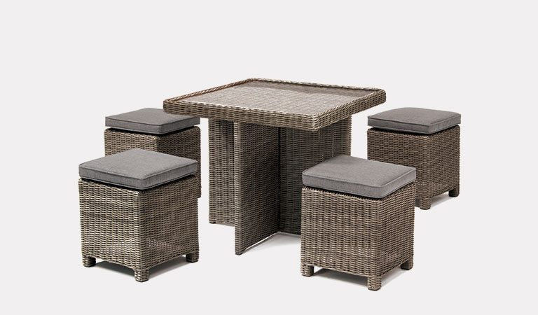 Cube Set with Glass Top Table in rattan from KETTLER's Casual Dining garden furniture range on a grey background.