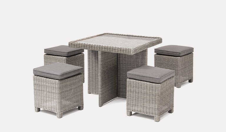 Cube Set with Glass Top Table in white wash from KETTLER's Casual Dining garden furniture range on a grey background.