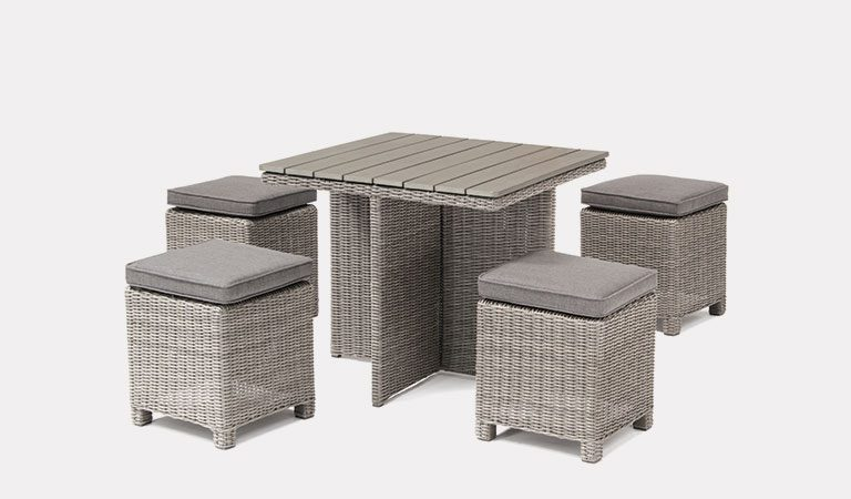 Cube Set with Dark Oak Slat Top Table in white wash from KETTLER's Casual Dining garden furniture range on a grey background.