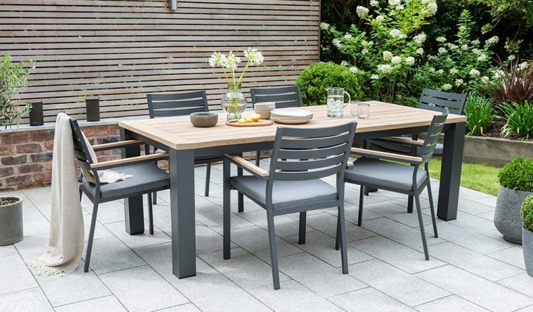 Elba 6 Seat Dining set on a patio in the garden.