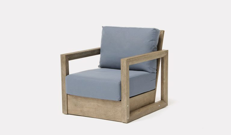 The Ezra Armchair from KETTLER's Casual Dining Garden furniture range on a grey background.