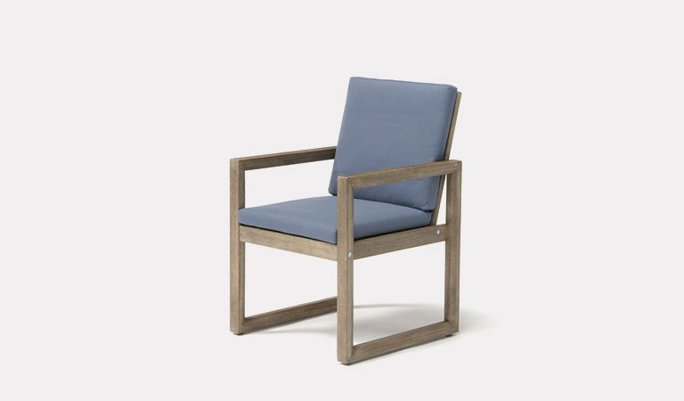 The Ezra Dining Armchair from KETTLER's Elegance Garden furniture range on a grey background.