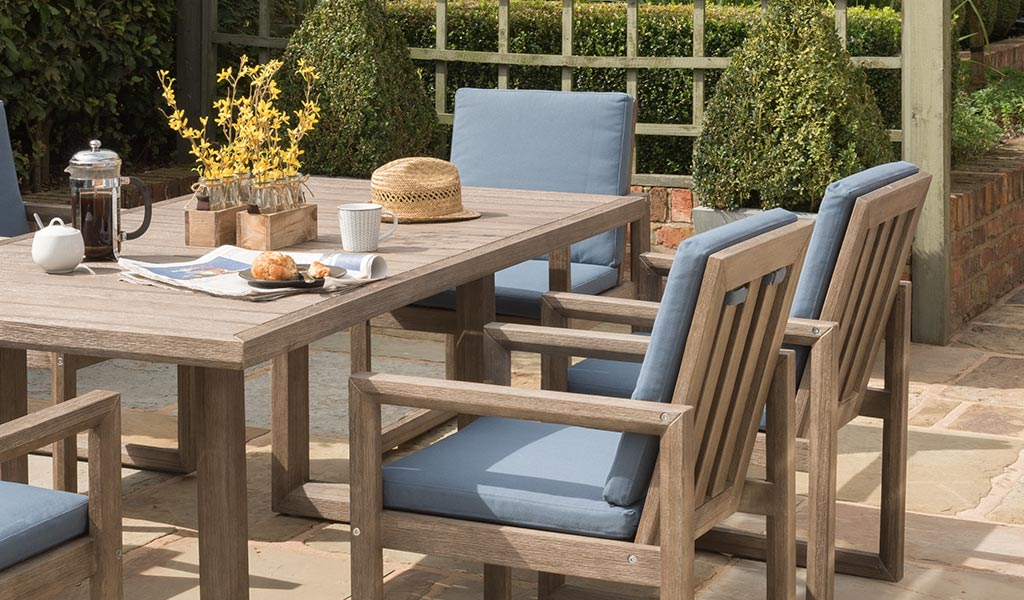 Ezra Dining Chair and Table from KETTLER's Elegance Garden Furniture range in a garden.