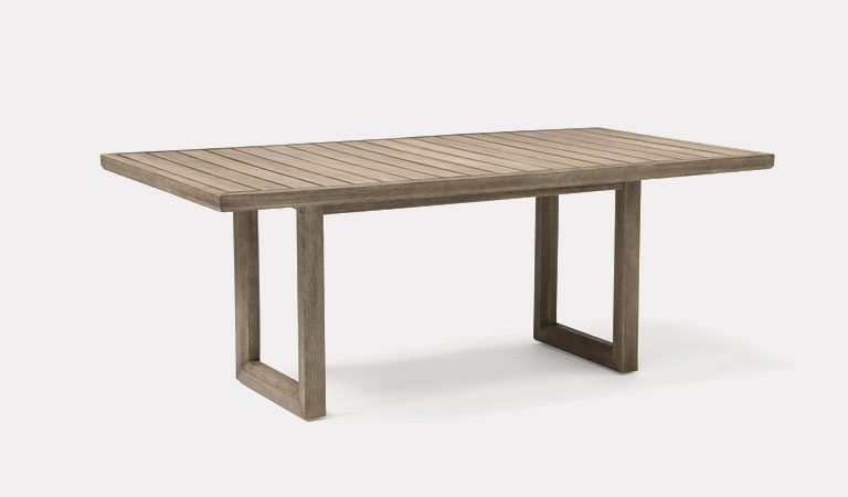 Ezra Dining Table from KETTLER's Elegance garden furniture range on a grey background.