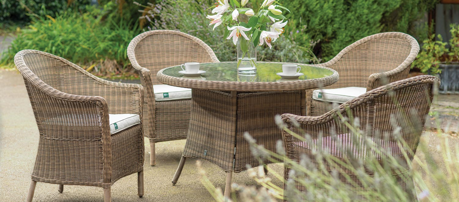 RHS Harlow Carr 4 Seater Dining Set from the RHS by KETTLER Garden furniture range on a sanded patio.