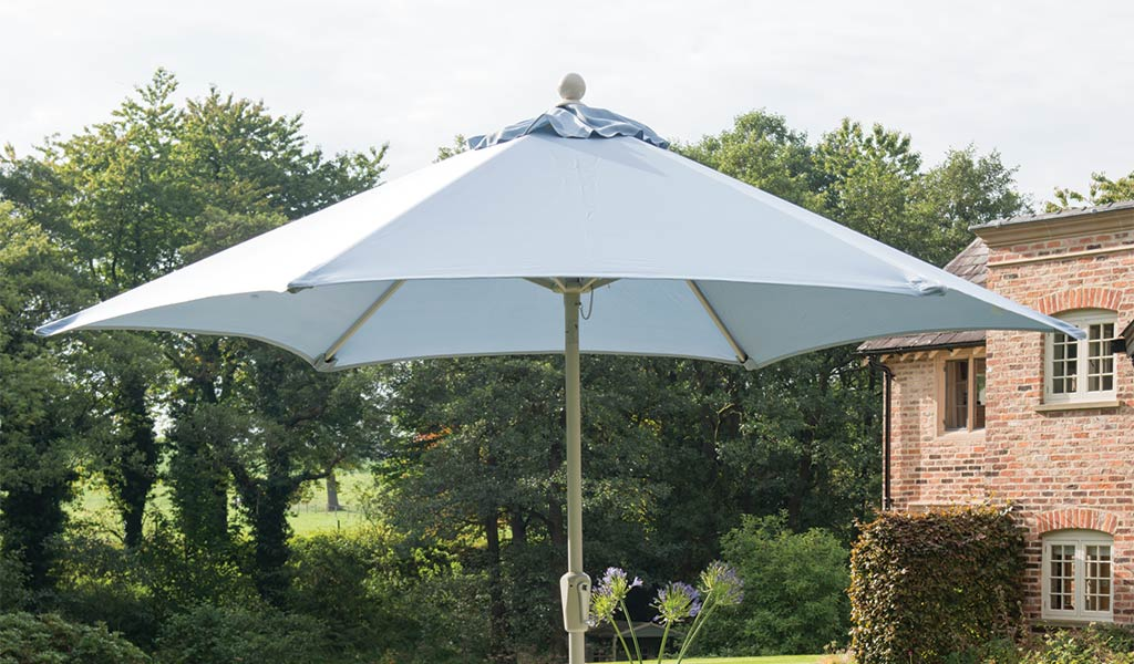 2.9m Wind up Parasol in a garden..