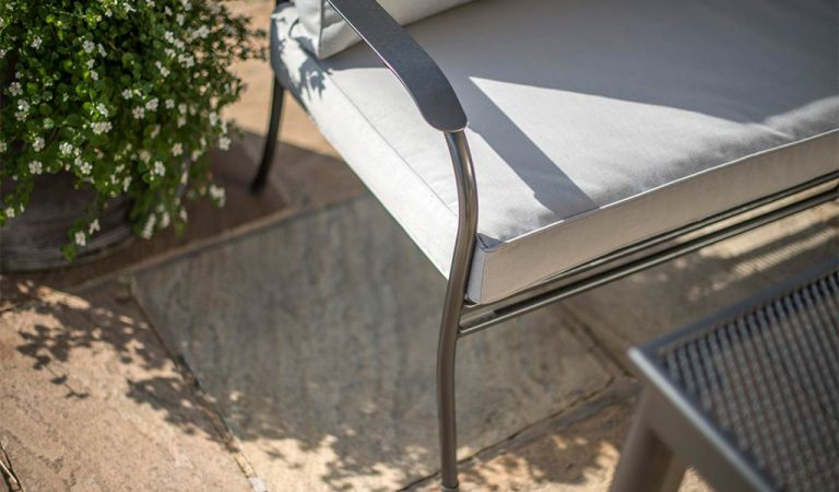 Detail of the Henley Corner Set in Iron Grey from the KETTLER at John Lewis garden furniture range on a patio.