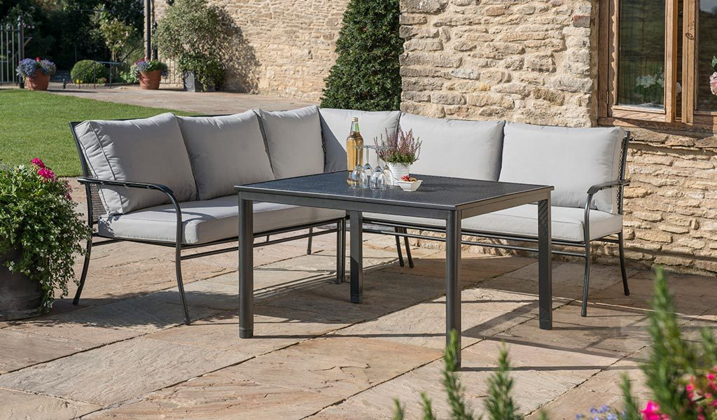 Henley Corner Set in Iron Grey from the KETTLER at John Lewis garden furniture range on a patio.
