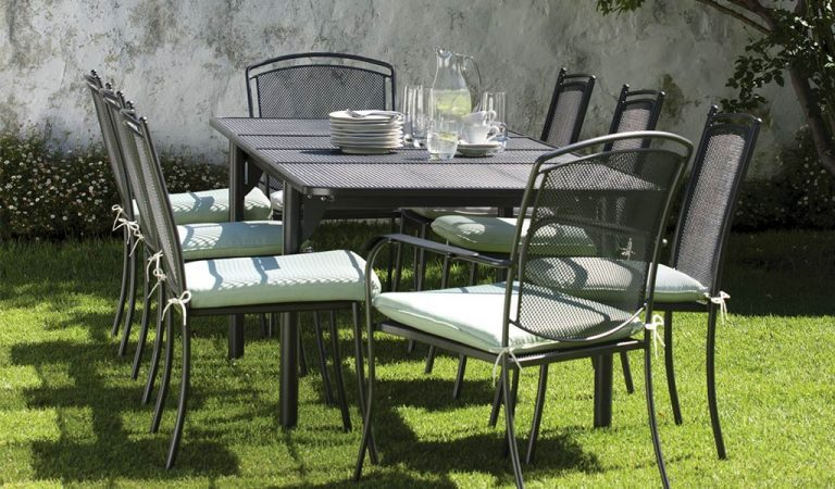 Henley Dining Set in Iron Grey from the KETTLER at John Lewis garden furniture range on a lawn.