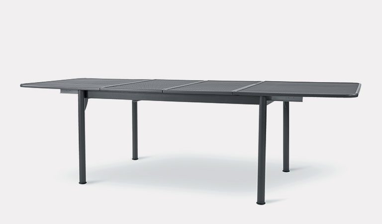 Henley Extending Table in Iron Grey from the KETTLER at John Lewis metal garden furniture range on a grey background.