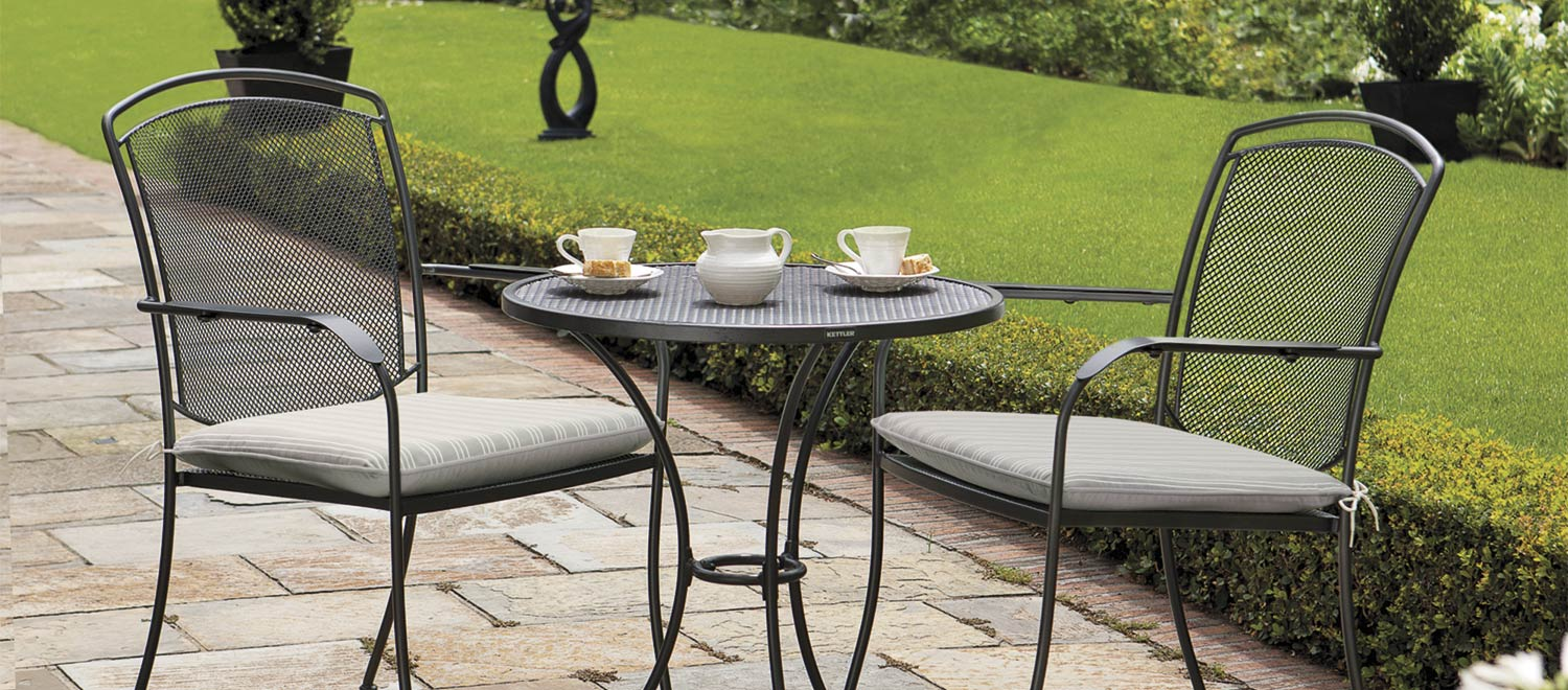 Henley Dining Set in Iron Grey with cushions from the KETTLER at John Lewis metal garden furniture range on a patio