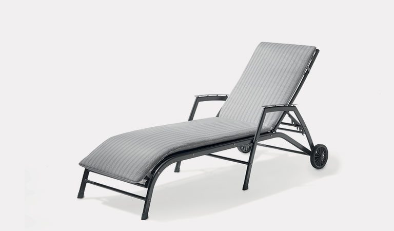 Henley Lounger with Cushion in Iron Grey from the KETTLER at John Lewis metal garden furniture range on a grey background.