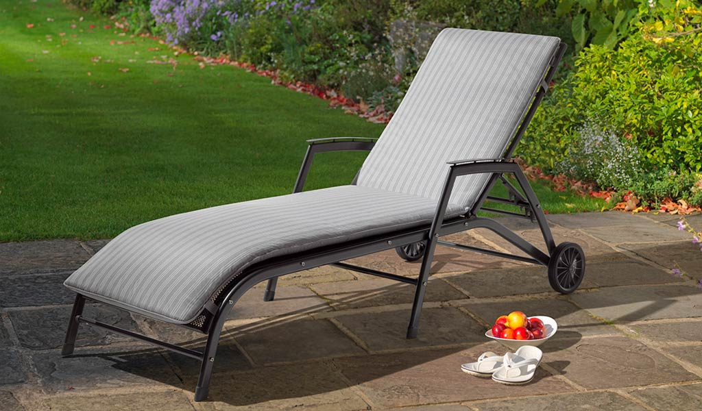 Henley Lounger with Cushion in Iron Grey from the KETTLER at John Lewis metal garden furniture range on a patio.
