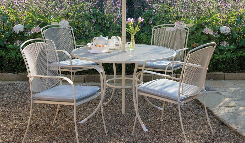 Henley Dining Set in Mellow Mocha from the KETTLER at John Lewis garden furniture range on a stoned patio..