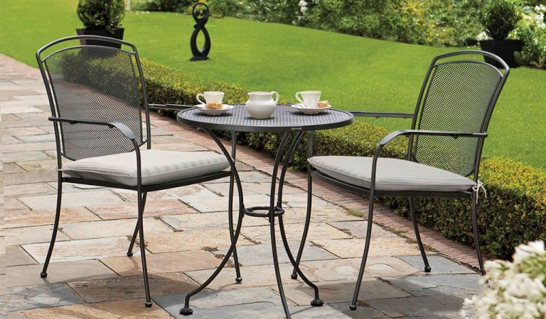 Henley Bistro Set in Iron Grey with cushions from the KETTLER at John Lewis metal garden furniture range on a patio
