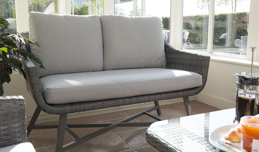 LaMode 2 Seater Sofa from KETTLER's Elegance range in a conservatory