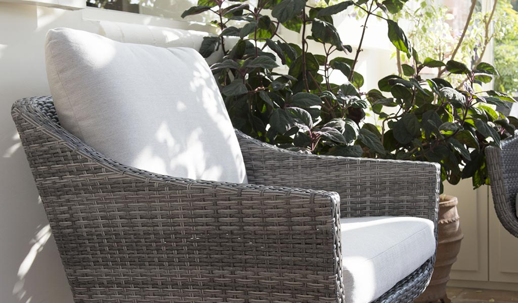 Detail of the LaMode lounge armchair from KETTLER's Elegance garden furniture range in a conservatory