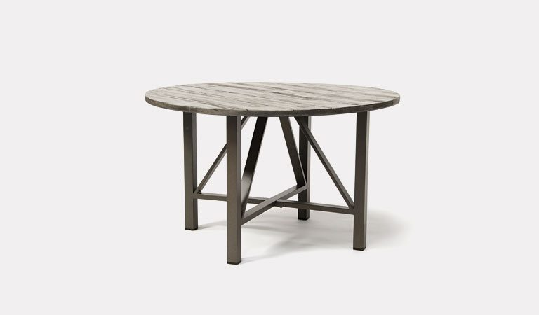 LaMode Round Dining Table from KETTLER's Elegance garden furniture range on a grey background.