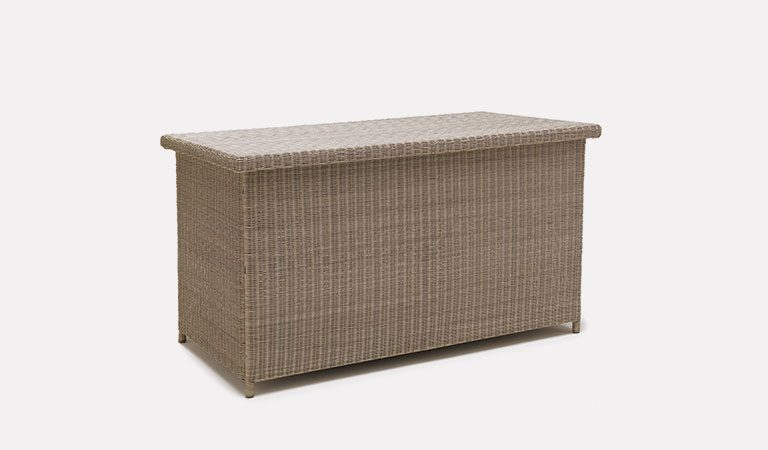 Large Cushion Box in Rattan from the Palma wicker range on a grey background.