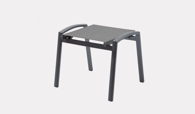 The Liveda Footstool from the KETTLER at Notcutts metal garden furniture range on a grey background.
