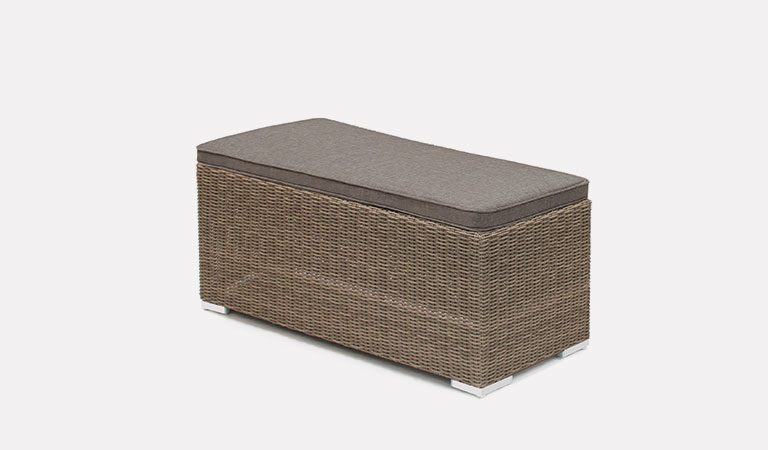 The Madrid Bench in rattan from KETTLER's Casual Dining Garden furniture range on a grey background.