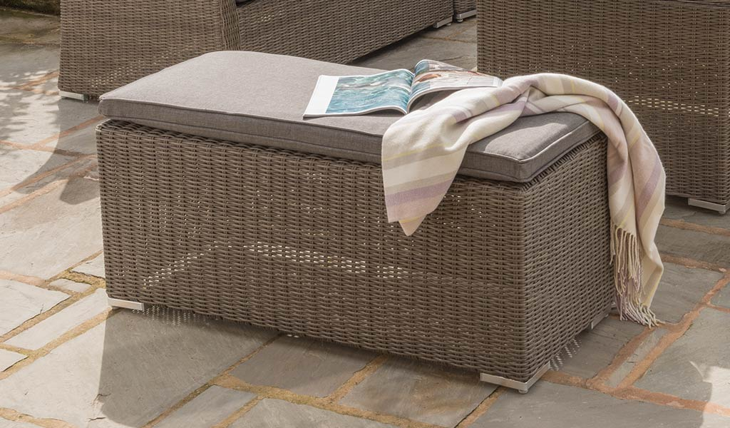 Detail of the Madrid Bench and Bench in rattan from KETTLER's Casual Dining range on a patio