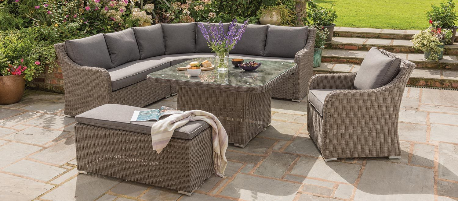 Madrid Corner Set with Armchair and Bench in rattan from KETTLER's Casual Dining range on a patio