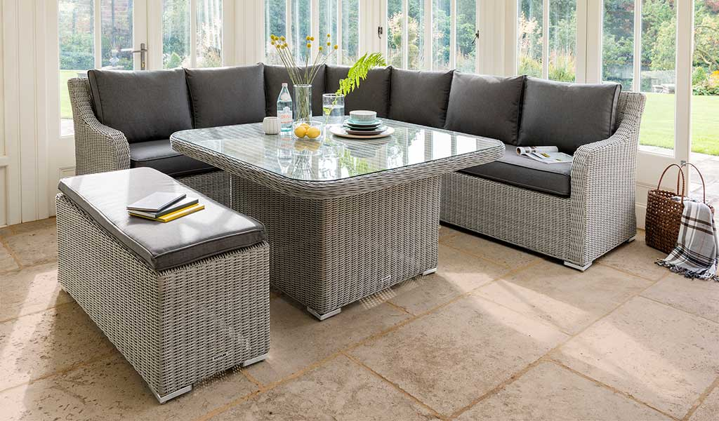 Madrid Corner Set and Bench in white wash from KETTLER's Casual Dining range on a patio