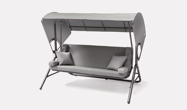 The Novero Swing / Daybed with slate cushion & canopy from KETTLER's Classic Garden furniture range on a grey background.